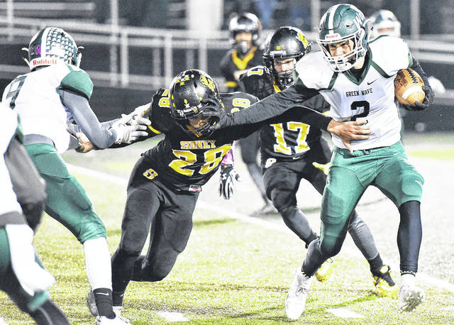 Sidney's Clay Carter goes after Greenville's John Butsch on Friday nigth at Sidney.