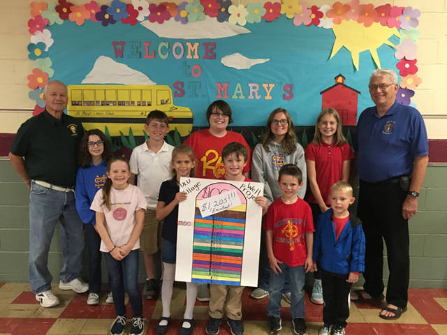 St. Mary's students raised $1,205 for the Knights of Columbus Ulu Village Well project. St. Mary's students are pictured with Grand Knight Luke Staugler and Max Litke of the Knights of Columbus. Anyone who would like to donate to the project may send a check to Mary's School, 238 W. Third St., Greenville.
