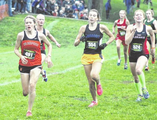 Bradford's Karmen Knepp (left) sprints toward the finish line to finish in ninth place individually just ahead of runners from Summit Country Day (center) and Fort Loramie (right). Knepp and the Bradford girls team finished third overall with 120 points to punch their ticket to the state meet for the first time in school history.