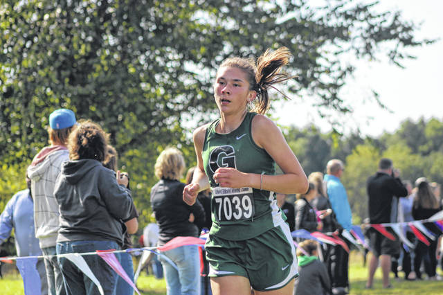 Greenville's Lauren Dull nears the finish line on Saturday during the Jim Murray Memorial/Buck Creek Invitational at Buck Creek State Park in Springfield. Dull finished the race in a time of 24:03.9.