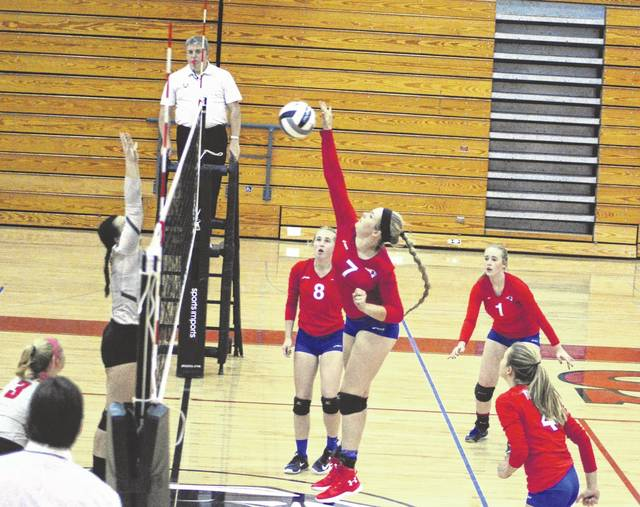 Tri-Village's Maddie Downing crushes the ball back toward the Twin Valley South side of the net during a match at the Panthers home last Thursday. The Patriots won the match in three straight sets.