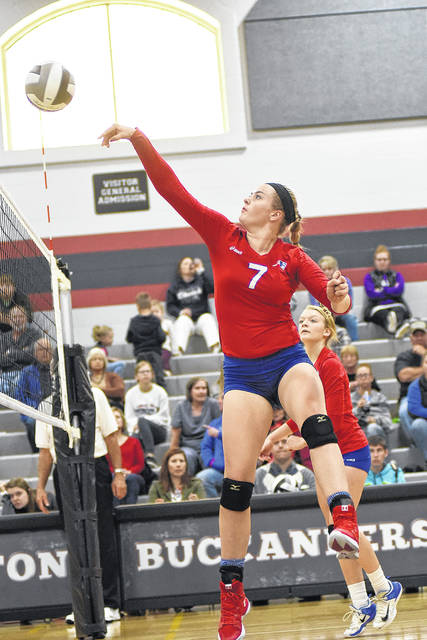 Maddie Downing (7) gets a tip over point for Tri-Village Wednesday night during a match with Southeastern in the Division IV sectional tournament at Covington. The Patriots lost to the Trojans in four sets.