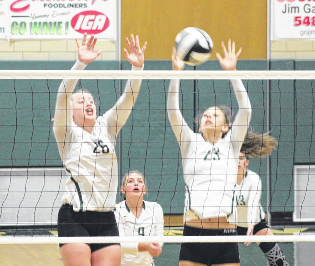 Greenville's Madilyn Francis (26) and Abbie Yoder (23) go up for a block during a match earlier this season. The Lady Wave are the sixth seed in the Division II New Carlisle Tecumseh Sectional Tournament, which begins play next week.
