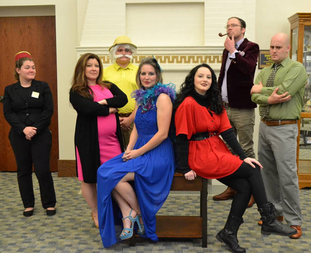 The Greenville Public Library will host a Clue-themed mystery event on Oct. 26. Pictured are Bellhop, Sierra Perry; Dr. Orchid, Julie Kennett; Mr. Mustard, Zach Perry; Mrs. Peacock, Rachel Brock; Miss Scarlet, Caitlyn Clark; Professor Plumb, David Nilsen; and Mr. Green, Reuben Kennett. Not pictured is Mr. Boddy, John Vehre.