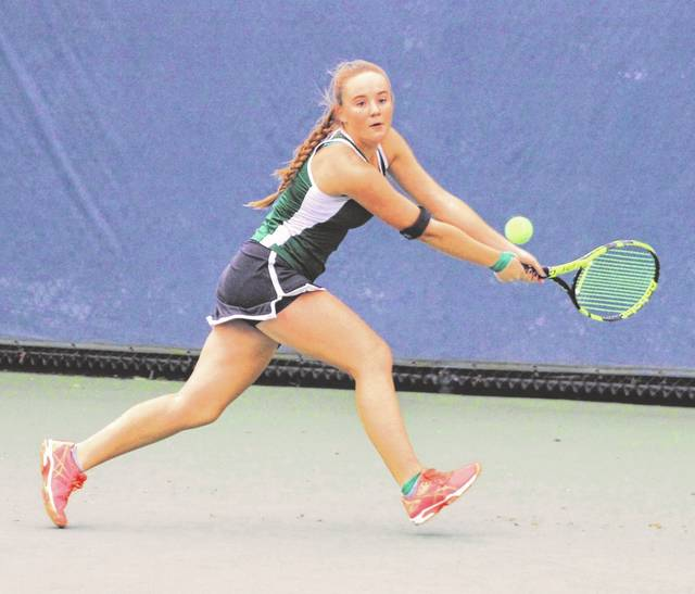 Greenville junior Natalie Milligan competes in a first-round match against Loveland junior Anna Svitkovich on Thursday in the Division I district tournament at the ATP Lindner Family Tennis Center in Mason.