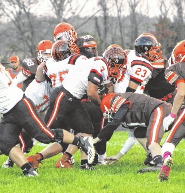 Reece Stammen bulls his way through the National Trail defensive line during the Tigers 20-17 win over the Blazers last Friday.