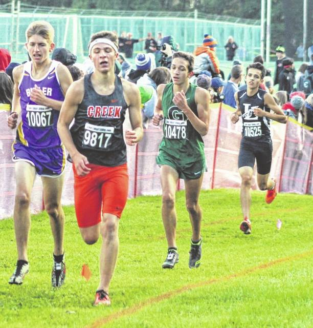 Greenville sophomore Riley Emerick (third from left) tries to keep pace with the runners in front of him during the Greater Western Ohio Conference cross country championships on Saturday at Northmont High School. Emerick finished 22nd overall in the boys race.