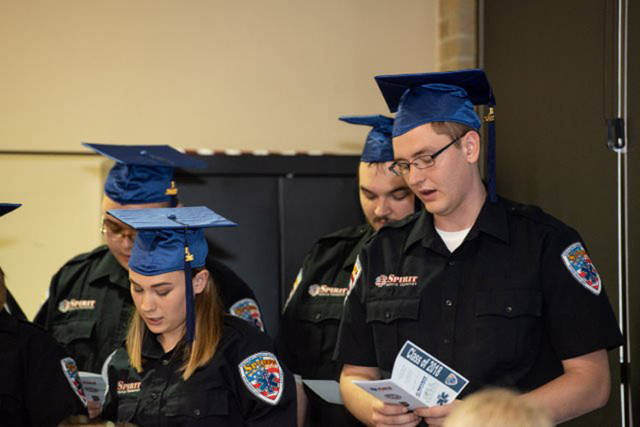 Spirit's recent EMT graduates recite the EMT prayer during a recent commencement ceremony recognizing their successful completion of the EMT program. Pictured are (front row, l-r) Whitney Reffitt, Cory Weaver, (back row, l-r) Nolan Hensley and Kyle Hinton. Since graduating, all four are working in the field full time at Spirit.