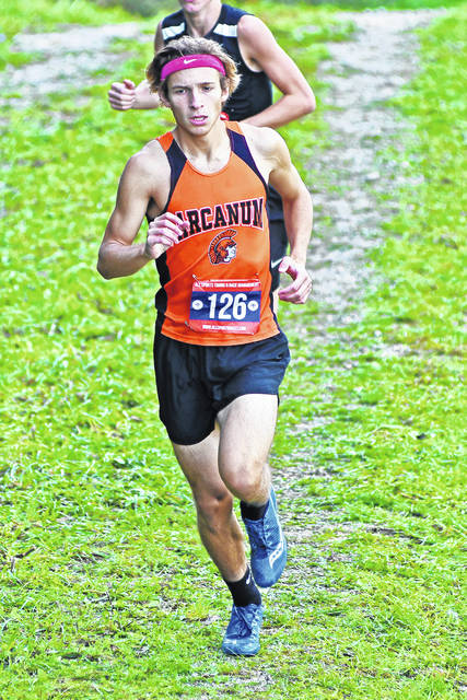 Arcanum's Tanner Delk won the Cross County Conference boys individual cross country title on Saturday at Tri-Village. Delk completed the course in a time of 16 minutes, 39.38 seconds. The Arcanum boys teams also won the team championship with a score of 64. It was the first time in 25 years the Trojans have won the CCC title.