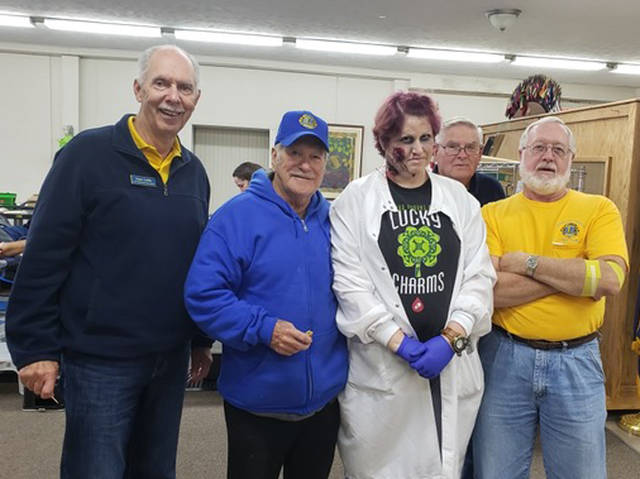Union City Lions members Owen Griffith, George Green, Francis Hoggatt and Mick Carpenter are pictured with Community Blood Center team leader Amanda, who dressed for Halloween.