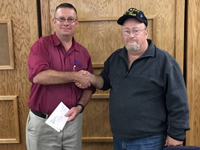 Union City Lions Club President Joe Wyant (left) is pictured with Jeff Gard, who gave a donation to the club.