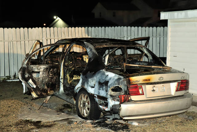 A gray Kia Optima located in an off-street parking area behind a residence was destroyed in a suspicious fire Tuesday night.