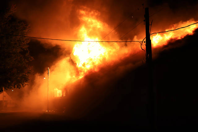 A three alarm fire Thursday night destroyed the Swine Barn at the Darke County Fairgrounds.