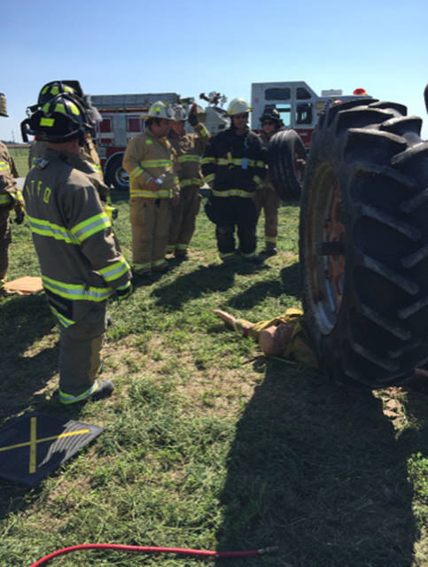 Firefighters and EMS worked together at the farm safety training put on by the Versailles FFA.
