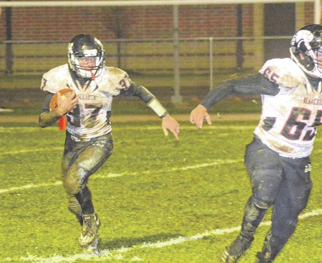 Mississinawa Valley's Will Hall (37) runs around the right end for a gain against Bethel on Friday night. The Bees shut out the Blackhawks 30-0.