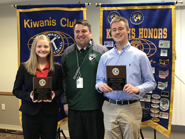 Greenville Kiwanis Club recognized Alyssa York (left) and Max Erwin (right) as its students of the month for August 2018. They are pictured with Greenville High School Principal Stan Hughes.