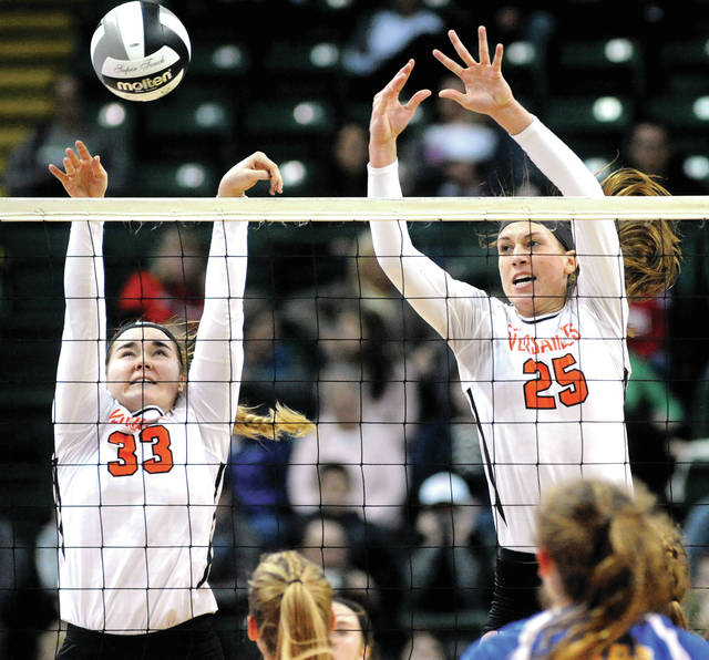 Versailles' Kelsey Custenborder, left, and Lindsey Winner go for a block during the Division III state final on Saturday at Wright State's Nutter Center in Fairborn.