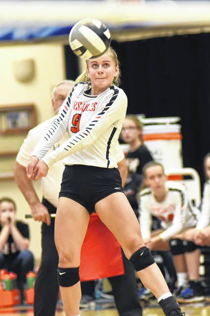 Alexa Didier keeps the ball in play for Versailles during the Division III regional championship match against Marion Pleasant on Saturday. The Tigers won the regional title and now will face Zoarville Tuscarawas Valley at 6 p.m. on Thursday in the state semifinals at Wright State University's Nutter Center.