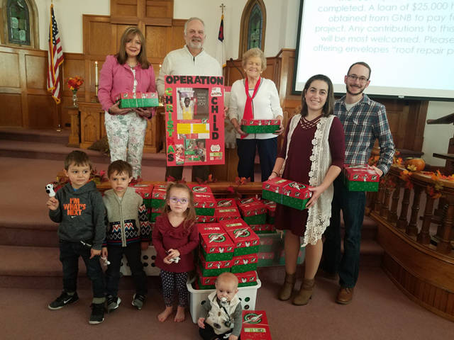 Faith United Methodist Church participated in Operation Christmas Child. Pictured are (front row) Kip Lee Krueger, (second row, l-r) Ezra Wieser, Elijah Wieser, Celia Spandt, Anissa Krueger, Chuck Krueger, (back row, l-r) Kay Wieser, Jim Wieser and Sharon Karns.