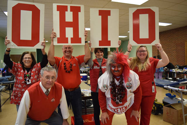 "Darke County OSU Alumni Club members and Community Blood Center staff are pictured with with super fans Larry ""Buckeyeman"" Lokai and Dennis ""Tress"" Singleton."