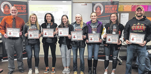 Bradford High School's girls cross country team was recognized during this week's Bradford Board of Education meeting. Pictured (l-r) are Coach Bob Daugherty, Austy Miller, Mercedes Smith, Olivia Daugherty, Alexis Barhorst, Jenna Shellabarger, Skipp Miller and Coach Rob Grillot. Not pictured is Karmen Knepp.