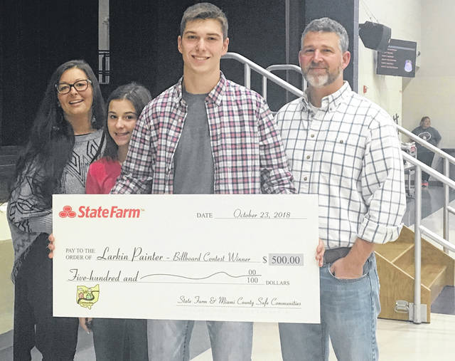 The Miami County Safe Communities Coalition awarded Bradford High School senior Larkin Painter with a $500 prize for his billboard design on Friday. Pictured (l-r) are Larkin's mother, Sara Painter; his sister Izabella; Larkin Painter and his father, Jerame Painter; with his prize check from State Farm.