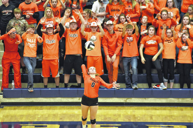 Caitlin McEldowney serves during the first set with the support of the Versailles student section behind her on Thursday night in the Division III regional semifinals against Miami East in Kettering's Trent Arena. The Tigers swept the Vikings in straight sets to advance to Saturday's regional championship match against Marion Pleasant.