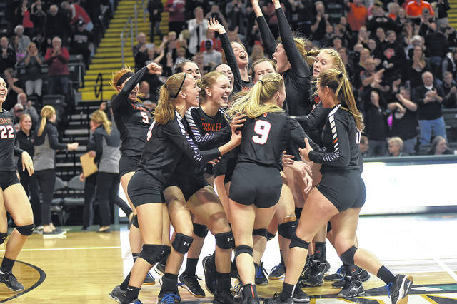 The Versailles volleyball team celebrates after defeating Zoarville Tuscarawas Valley 3-0 on Thursday in a Division III state semifinal match at Wright State University's Nutter Center. The Tigers will try for a second straight state championship at 1 p.m. on Saturday against Independence.