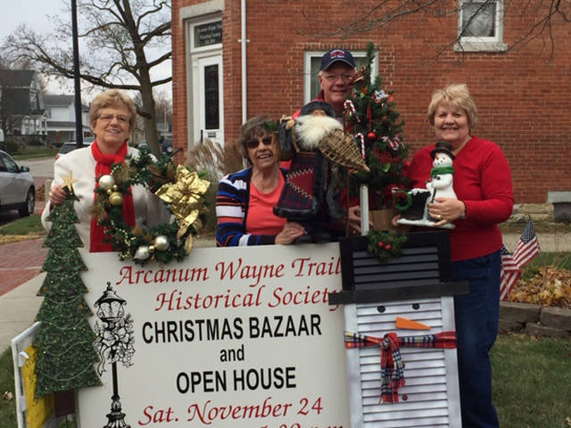 Wayne Trail Historical Society members (l-r) Barb Deis, Carolyn Furlong, Fred Troutwine and Sharon Troutwine are pictured with Christmas Bazaar treasures.