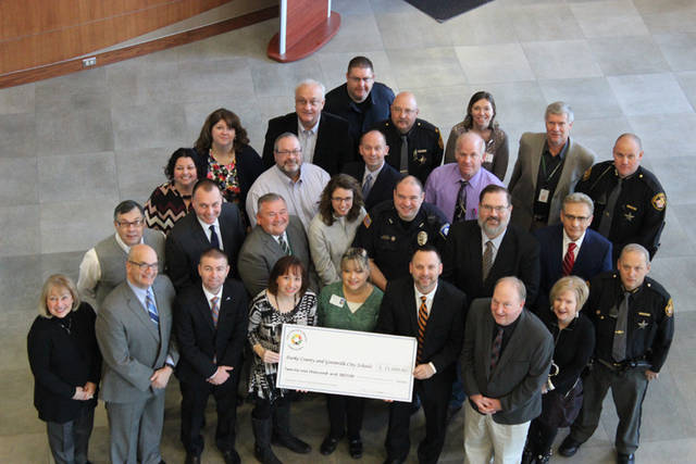 The Coalition distribution of Substance Abuse Prevention Education Grants in 2017-18 totaling $21,000 was celebrated with a photo of community members that received grants including the school districts of Arcanum-Butler, Franklin Monroe, Greenville, Mississinawa Valley and Tri-Village. Additionally, St. Mary's Catholic School and the peer-led student group We Are The Majority received grants. Joining the photo were school representatives, school resource officers, Coalition board members, Darke County Chamber board members and donors.