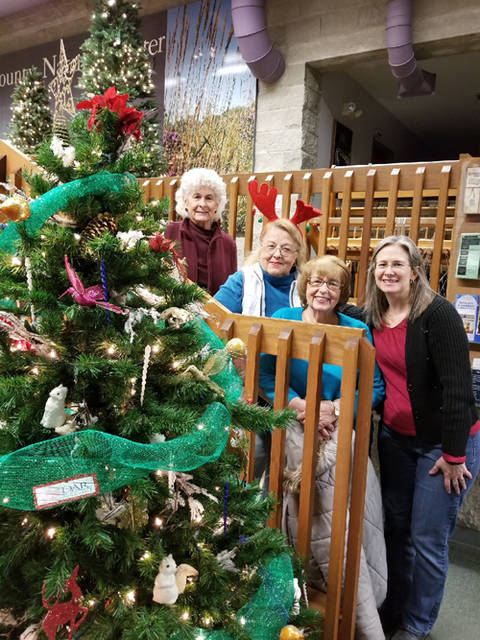 The Greenville Daughters of the American Revolution helped to decorate one of the Darke County Parks Nature Education Center's trees.