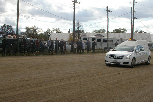 Family and friends watched Tuesday morning as a hearse transported Dick Weherley around the track at the Darke County Fairgrounds for a final time. Weherley, who died Friday, owned Standardbred race horses and was a member of the Darke County Horseman's Association. In 2017 he received the Horse of the Year award. After funeral services at Zechar Bailey Funeral Home in Greenville, a procession of cars stopped at the Fairgrounds and watched the hearse make two laps around the track before proceeding to Mote Cemetery near Pitsburg for burial. At the 2019 Darke County Fair, a 3-year-old filly pace will be named in memory of Dick Weherley and his father, Waldo, another former race horse owner. The race in their memory will be on the first Saturday of the Fair.