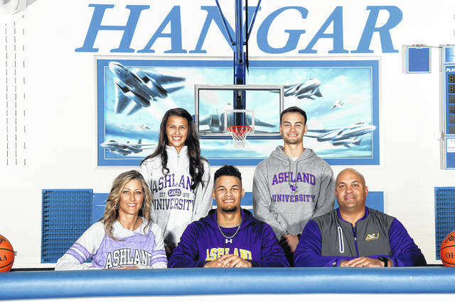 Franklin-Monroe senior Ethan Conley is surrounded by his family on Saturday in The Hangar as he signs his National Letter of Intent to play basketball at Ashland University. Standing in the back row (left to right) are Ethan's sister Corina Conley and brother Mason Conley. Sitting (left to right) are Ethan's mother Rebecca Conley, Ethan Conley and his father Javan Conley.