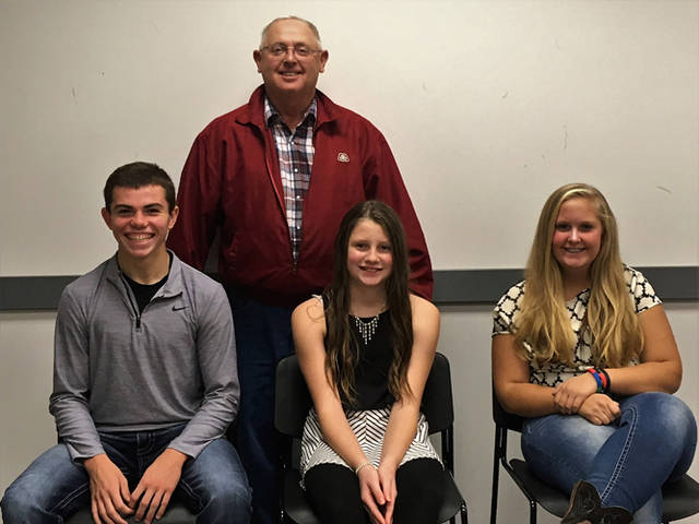 Darke County Farmers Union held its Fall Harvest meeting on Oct. 27 at the OSU Extension meeting room where they honored some of the 4H youth that they supported during the livestock sales at the 2018 Great Darke County Fair. Pictured are (seated l-r) Ethan Fischer, sheep; Faith Wooten, swine; Adi Schmitz, sheep and (standing) Todd Rhoades, Darke County Farmers Union president.