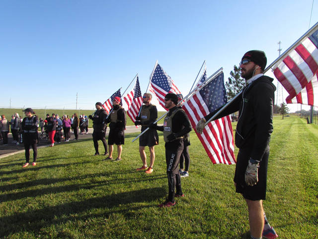 Trent Kline, Matt Shindeldecker, Ron Winhoven, Bo Maus, Eric Sutter and Shawn Stein each carried a flag for the entire course of the race to honor fallen heroes.