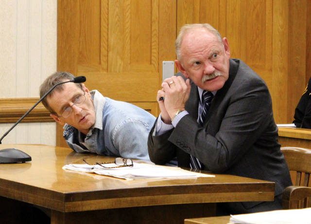 Dennis Yohey (left, with defense attorney Randall Breaden) was found guilty and sentenced to three years in prison as a result of an August arson incident.