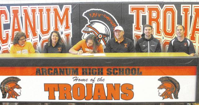 Arcanum senior Isabella Gable (center) is surrounded by family members as she signs her National Letter of Intent on Tuesday to continue her education and athletic career at the University of Tennessee. From left to right are grandmother Wilma Howard, mother Liz Gable, Isabella, father Jim Gable, brother Isaiah Gable and Arcanum swim coach Josh Artin.