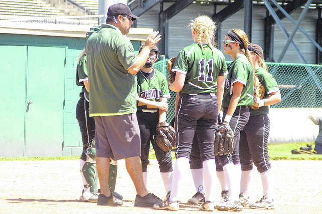 Greenville softball coach Jerrod Newland talks with his players during a game last season. Newland was recently announced as one of four members of the Class of 2018 for the Ohio High School Fastpitch Softball Coaches Association Hall of Fame.
