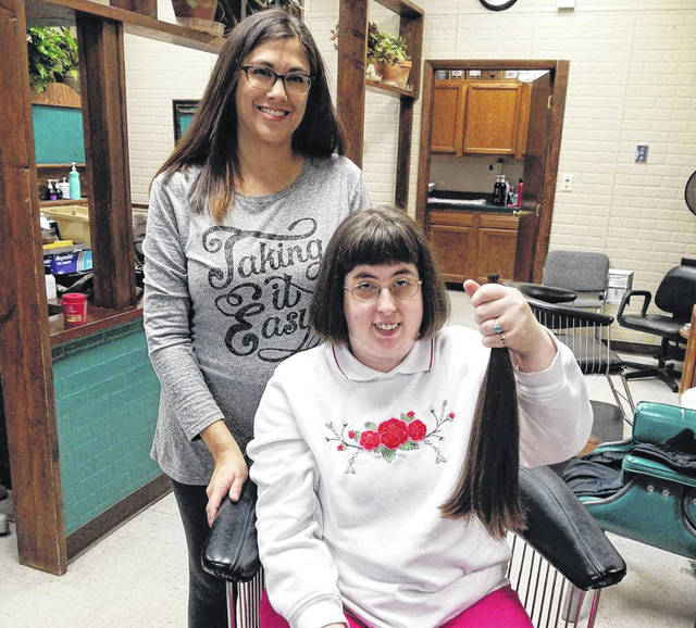 Kathy Varvel (with stylist Stacy Yagle) shows off her new hair style as well as her seventh donation to Locks of Love.