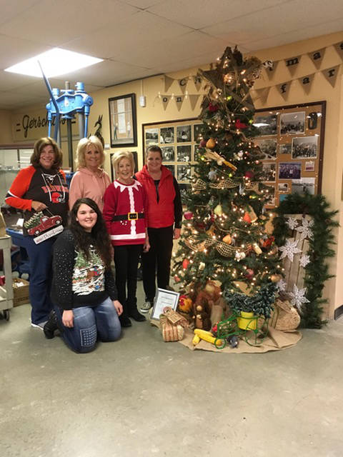 The Ladybug Garden Club members decorating a tree at the Garst Museum were Amy Erisman, Becky Collins, Chairperson Shirley Linder, Amy Addis and )seated) Mariana Ramos.