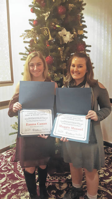 Bradford High School students Emma Canan (left) and Maggie Manuel (right) are pictured at the Mandalay Banquet Center in Moraine for the 2018 Awards Breakfast presented by Family Services. They each had essays recognized during the 18th annual Families Matter poster and essay contest presented by Family Services of Montgomery County.
