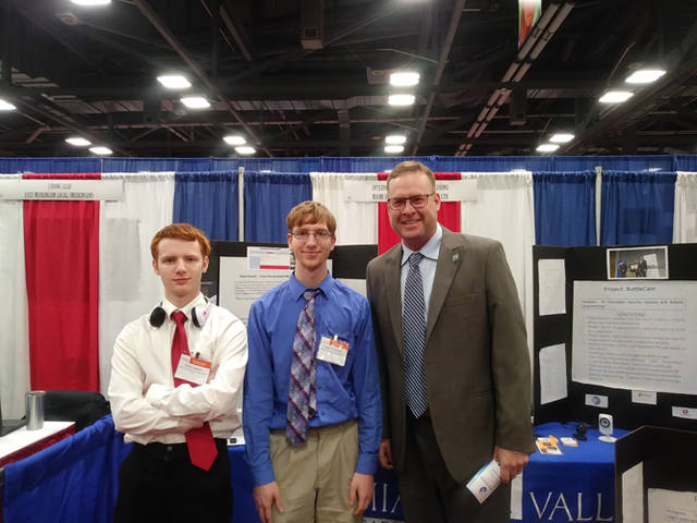Computer Coding and Web Applications seniors represent Miami Valley Career Technology Center at the Ohio School Board Association Student Achievement Fair in Columbus on Nov. 12. Pictured (l-r) are Chris Lawson (Huber Heights), Tyler Branham (Arcanum) and David Peltz (MVCTC supervisor).