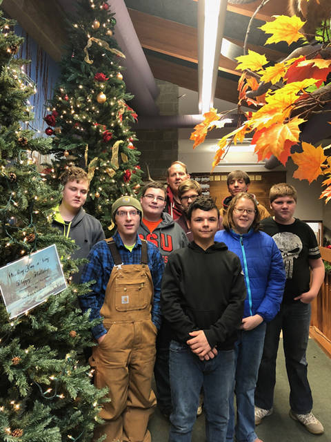 Arcanum High School Individualized Education Plan students Jason Sturdevant, Liz Cave, Josh Lambert, Hunter Farmer, Sheldon Bates, Leahvi Halderman, Austin Bailey and Lucas Bailey along with their teacher Eric Weibel helped decorate the Darke County Park District's Nature Center.