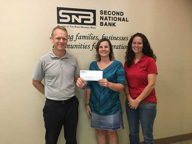 "Todd Durham, vice president/trust and investments officer, and Antonia Baker, assistant trust and investments officer of Second National Bank, are pictured with with DCCA Executive Director Andrea Jordan. SNB is an Impresario Sponsor for the 2018-19 DCCA Season including the upcoming special event ""The Texas Tenors in Deep in the Heart of Christmas."""