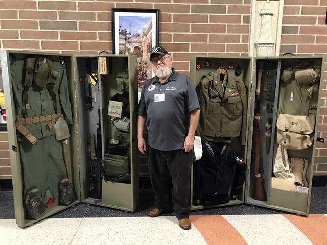 Terry Purke displayed artifacts from World War II, the Korean War and the Vietnam War on Wednesday at Versailles High School.