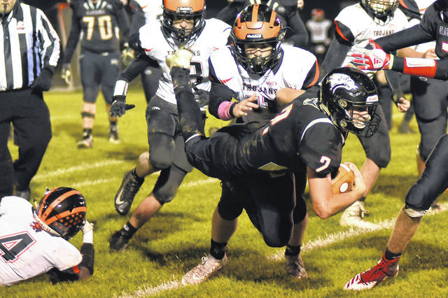 Mississinawa Valley quarterback Trent Collins dives forward for extra yardage in this game during the season.