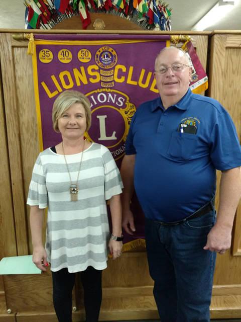 Penny Brunk (left), manager at Casey's in Union City, Indiana, is pictured with Lion Program Chairman Doug LeMaster.