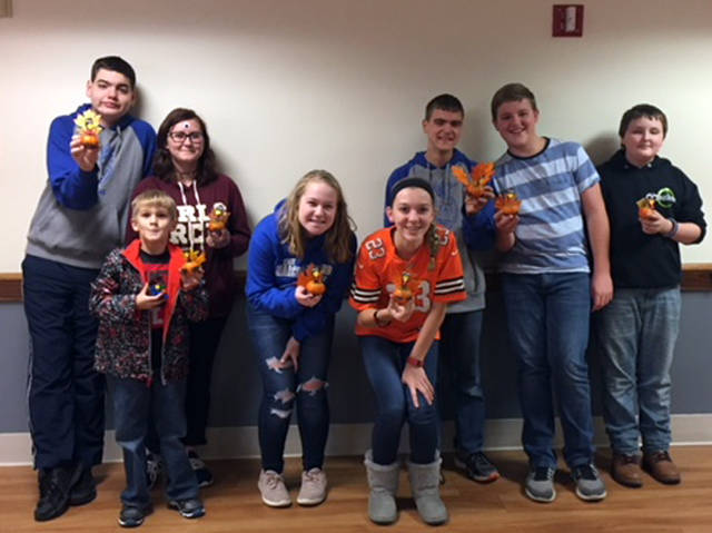 Versailles FFA members visited the Versailles Health Care Center for their monthly nursing home visit and made turkey pumpkins with the residents. FFA members who attended included (l-r) Zach Watren, Ashleigh Shimp, Paige Gasson, Lexi Demange, Greg Dircksen, Isaiah Hess and Koltin Hall.