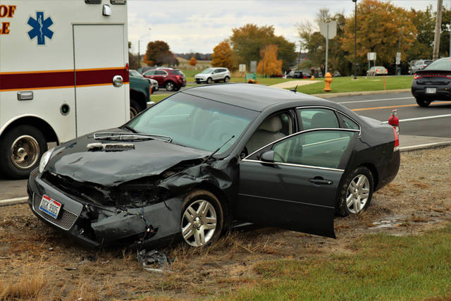 Three people suffered minor injuries in a two-vehicle crash on Friday at the intersection of Russ Road and State Route 121 in Greenville.