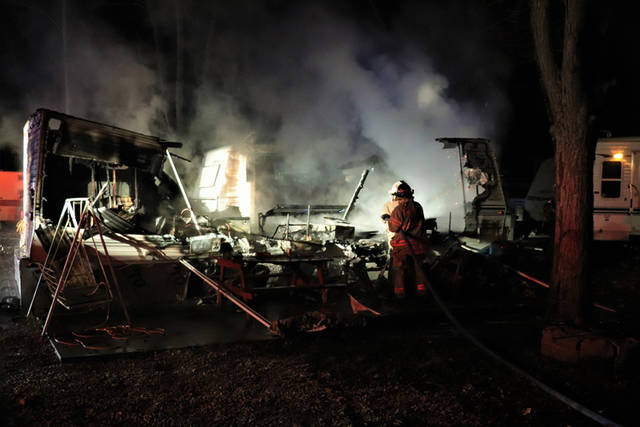 A Wyoming man escaped a fire at Stillwater Beach Campground that destroyed two travel trailers.